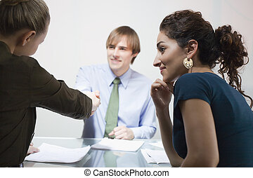 Three Businesspeople in Meeting - Three businesspeople in...