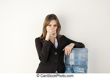 Office Worker at Water Cooler - Female office worker getting...