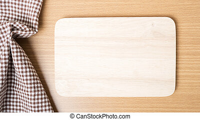 cutting board and kitchen towel on table
