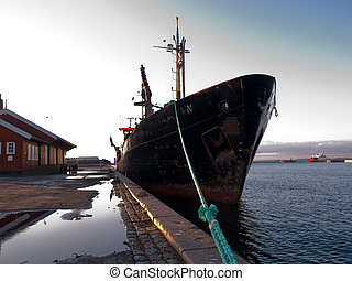 Cargo boat moored in a port