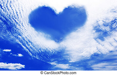 Clouds making a heart shape againt blue sky - White clouds...