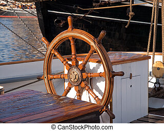 Ship steering wheel on a sailing boat - Beautiful...