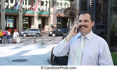 Business man phone speaking outdoor