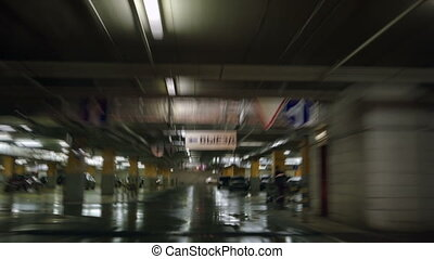Parking garage underground, industrial interior.