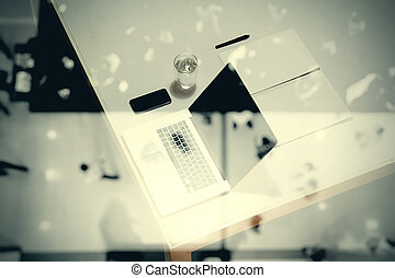 top view of  business documents on office table with digital tablet and man working with smart laptop computer