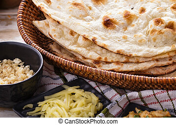 indian naan bread and paneer - close up portrait of indian...