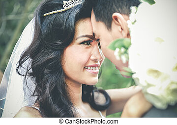beautiful bride and groom touching forehead - close up...