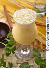 indian mango lassi - portrait of healthy fresh mango lassi