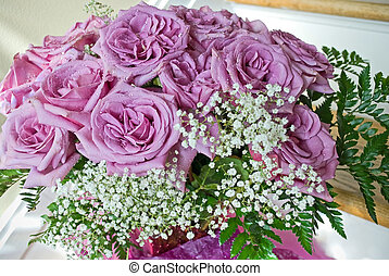 Purple Rose Bouquet - A bouquet of unusual purple roses in a...
