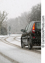 snowy highway - vehicle traveling on a highway during...