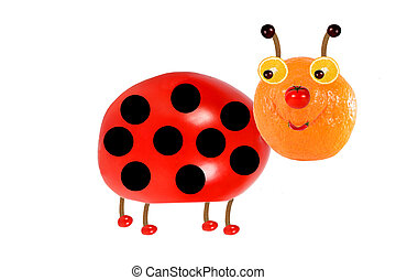 Creative food concept Funny little ladybird made from fruit...