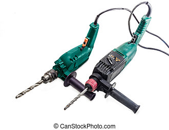 Electric drill and hammer drill on a light background -...