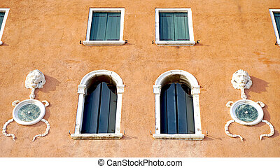 Windows on orange brown wall building architecture, Venice,...