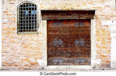 wooden door with brick wall building