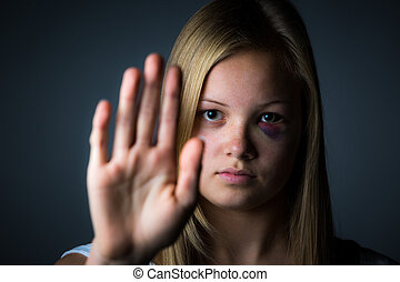 Stop abuse - Blonde teenage girl with black eye with hand up...