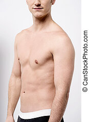 Mid section of muscular male - Cropped image of shirtless...