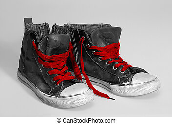 rundown sneakers - pair of rundown sneakers with red...