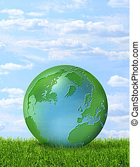 Green planet on green grass and blue sky - Green-blue planet...