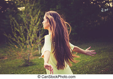 feel nature - young woman enjoy in summer wind in nature