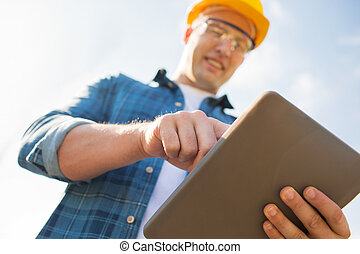 close up of builder in hardhat with tablet pc - business,...
