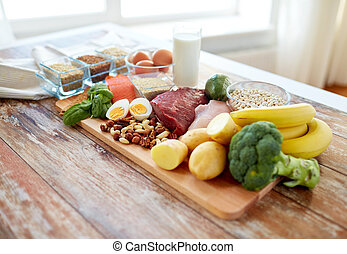 close up of different food items on table - balanced diet,...