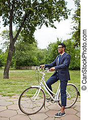 Agent on bicycle in park