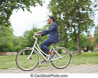 Riding bicycle in park