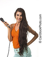 Lovely woman in orange shirt with microphone. - The brunette...