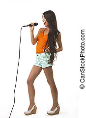 Lovely girl with the microphone. - Charming lady is singing...