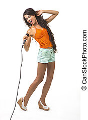 Pretty girl with the microphone. - Charming lady is singing...