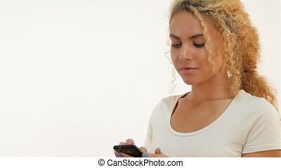 Mulatto woman texting on her mobile phone - Red-haired...