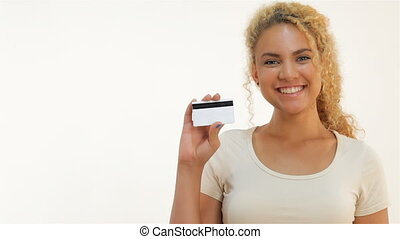 Mulatto girls showing thumbs-up with credit card - Happy...
