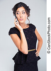 Woman in black dress talking on the phone - Beautiful woman...