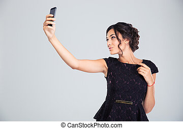 Woman in black dress making selfie photo - Attractive pretty...