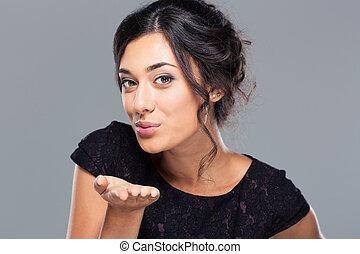 Woman blowing kiss at camera - Cute woman blowing kiss at...