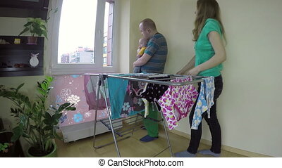 father with baby laundry - Father man hold baby girl on...
