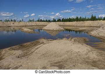 sand quarry - abandoned sand quarry with a mountain of sand...