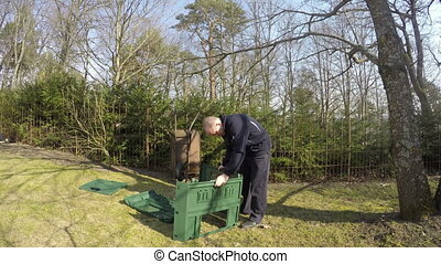 farmer compost box - farmer gardener man assemble plastic...