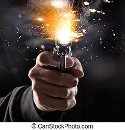 Killer with gun - Killer with gun close up over dark...