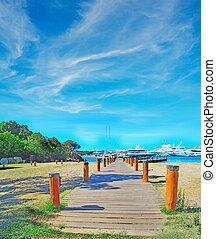 wooden boardwalk in Porto Cervo, Italy