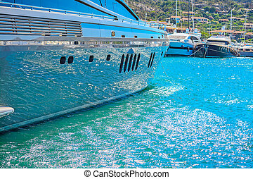 water reflected on a yacht hull in Porto Cervo harbor,...