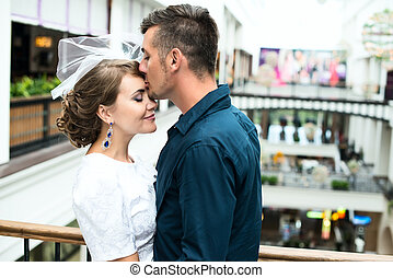the bride and groom in a shopping center