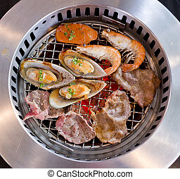 Mixed Roasted Meat and Seafood on the BBQ Grill on roast