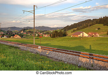 Railroad in swiss Alps before sunset