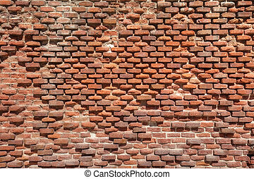 Old weathered brick wall as texture
