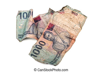 Conceptual photo of old dirty crumpled Indonesian Rupiah, illustrating criminal money, white washing or how cheap they are.