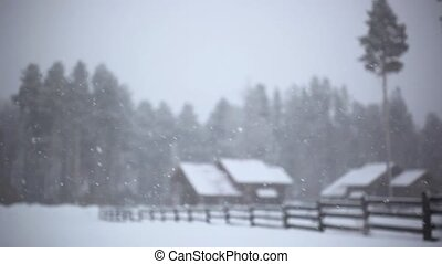 general view of the ski resort in Siberia In a blizzard. Wooden houses at forest . Changes focus on blurred