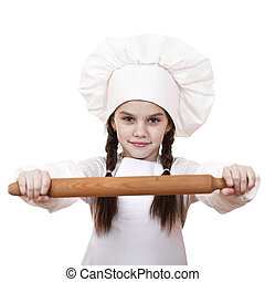ute little girl baking on kitchen and shows rolling-pin,...