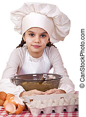 Cooking and people concept - smiling little girl in cook hat...