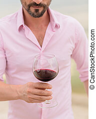 Sommelier - Close-up image of glass with red wine Sommelier...